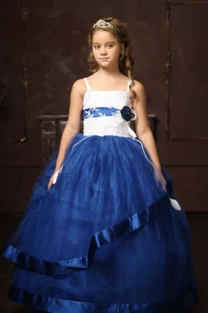 curtsy: little princess in blue smart dress and tiara