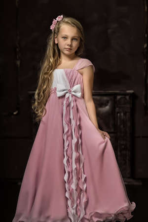 traditional dress: girl in a pink dress stylish retro Stock Photo