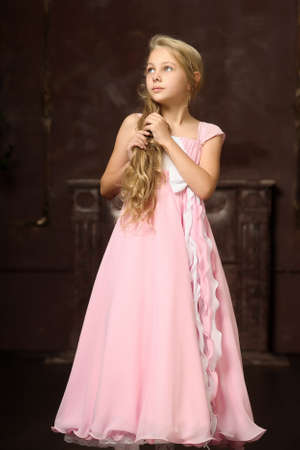 renaissance woman: girl in a pink dress stylish retro Stock Photo