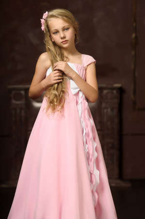 girl in a pink dress stylish retro photo