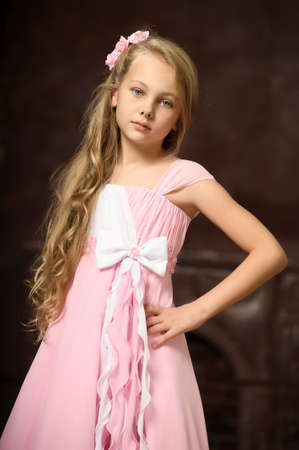 young girl: girl in a pink dress stylish retro Stock Photo