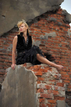 woman in black sitting on the ruins Stock Photo - 15305298