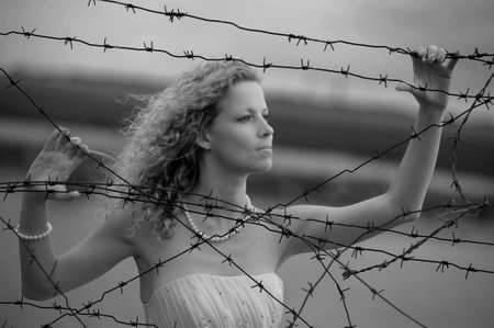war refugee: Bride with barbed wire