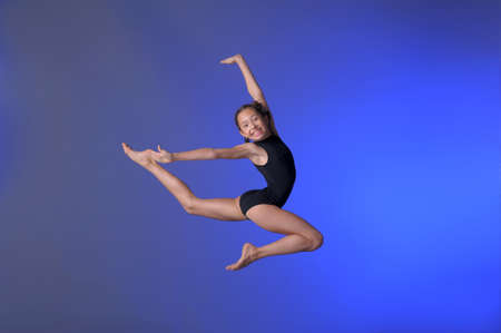 Gymnast girl jumping studio Stock Photo - 15392459
