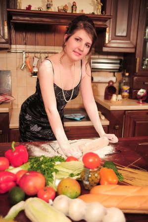 midlife: Housewife making dough Stock Photo
