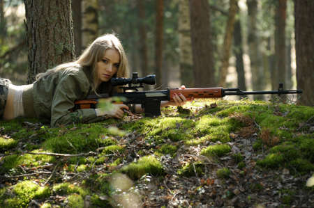 young blonde with a rifle in his hands Stock Photo - 15424967