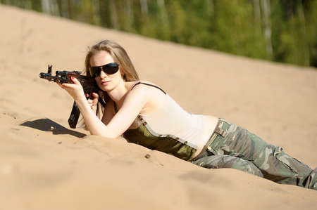 young blonde with a rifle in his hands Stock Photo - 15424957