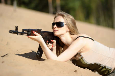 young blonde with a rifle in his hands Stock Photo - 15425636