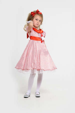 a little girl dressed in the style of the 60s Stock Photo - 15429015