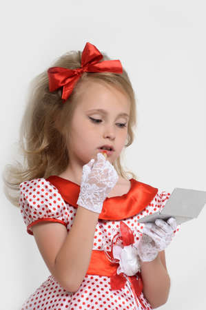 Pin-up girl applying her make-up photo