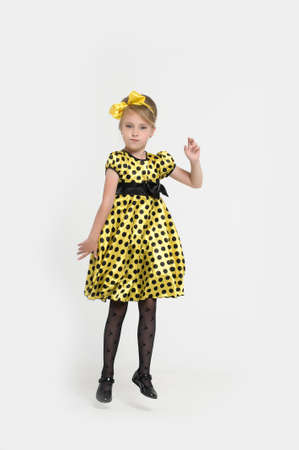A little girl dressed in the style of the 60s Stock Photo - 15479540