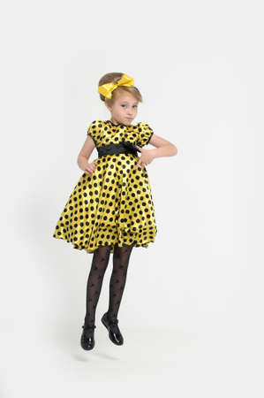 A little girl dressed in the style of the 60s Stock Photo - 15479563