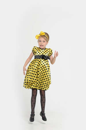 A little girl dressed in the style of the 60s Stock Photo - 15479562