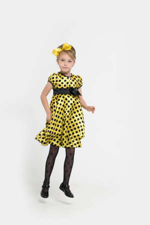 A little girl dressed in the style of the 60s  Stock Photo - 15479560