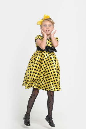 A little girl dressed in the style of the 60s  Stock Photo - 15479558