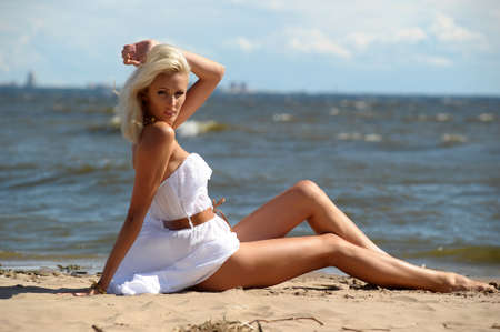 girl in a white dress on the coast Stock Photo - 15359056