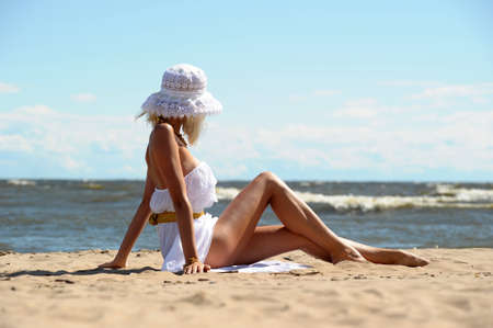 girl in a white dress on the coast photo