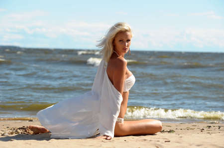 love hot body: girl in a white dress on the coast