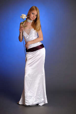 the blonde in a white evening dress Stock Photo - 15421702