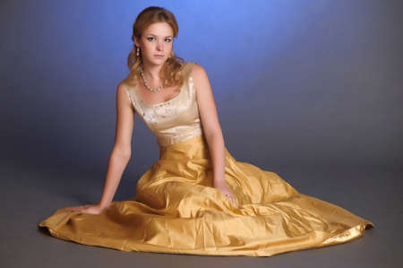 Stylish woman in a evening gown photo