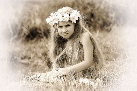 girl with a wreath of flowers Stock Photo - 15335903