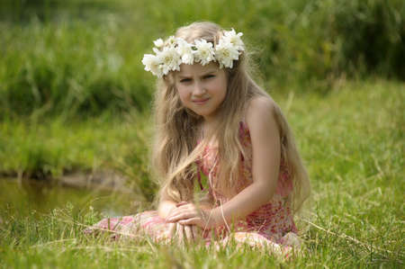 girl with a wreath of flowers photo