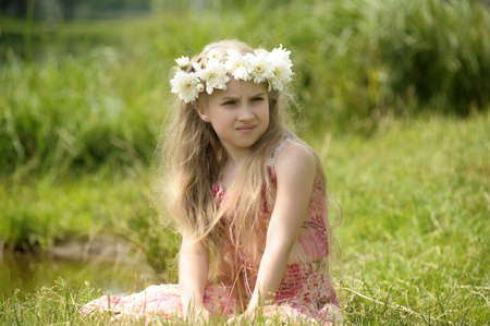 girl with a wreath of flowers Stock Photo