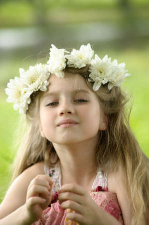 girl with a wreath of flowers Stock Photo - 15335898