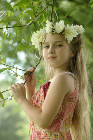 little bell: girl with a wreath of flowers Stock Photo