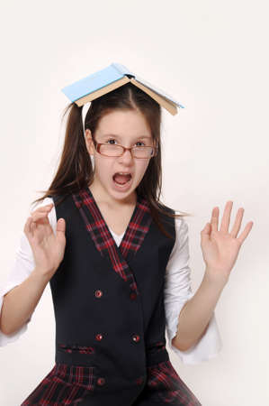 Schoolgirl is shocked by something Stock Photo - 15428167