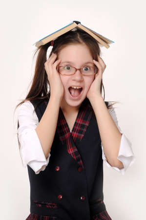 Schoolgirl is shocked by something Stock Photo - 15421520