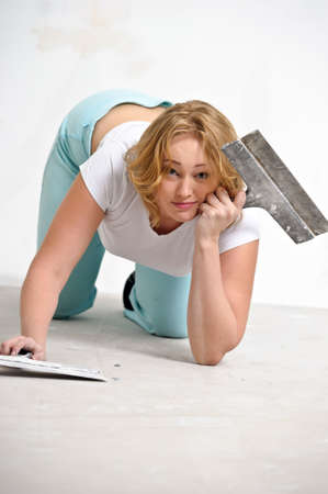girl doing repairs at home photo