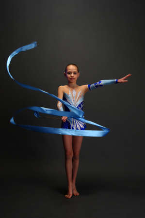 Girl gymnast with a ribbon photo