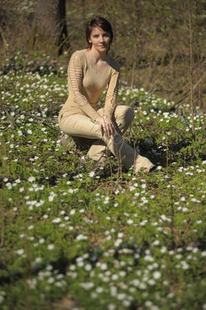 young woman in the spring forest photo