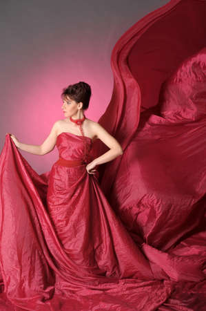 The beautiful girl in a long red dress Stock Photo - 15411174