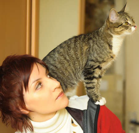 Woman holding her cat Stock Photo - 15455237