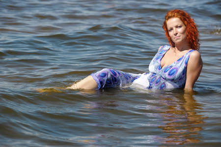 young woman in a dress in the water Stock Photo - 15412384