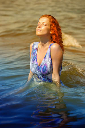 young woman in a dress in the water Stock Photo - 15412358