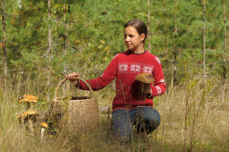 spliced: The girl the teenager with a basket and mushrooms
