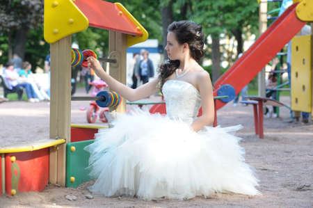 young bride on the playground Stock Photo - 15364438