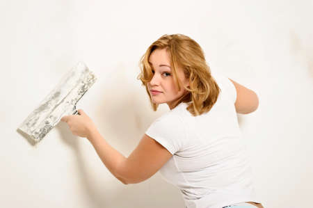 girl plastering the wall photo