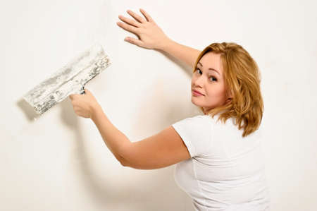 home painting: girl plastering the wall