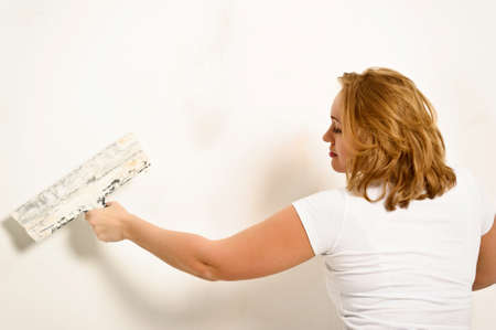 redesign: girl plastering the wall