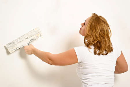 plastering: girl plastering the wall