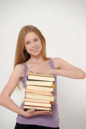 Student with books preparing for exams  Stock Photo - 15426497