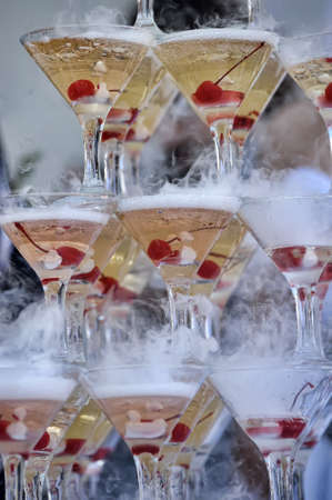 Champagne glasses tower in celebration party photo