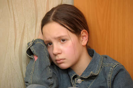 regretful: The girl the teenager in depression Stock Photo
