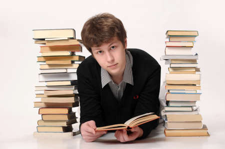 The student with a considerable quantity of books Stock Photo - 15455219