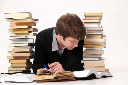 The student with a considerable quantity of books photo