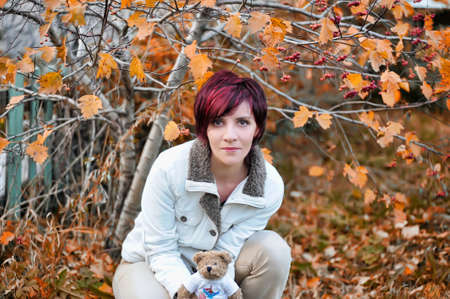 Young woman with autumn leaves Stock Photo - 15479380